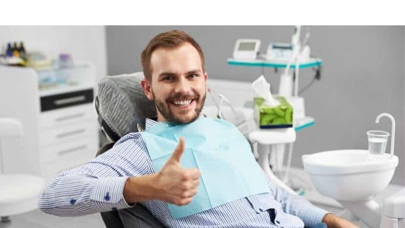 Happy patient in dentist's chair